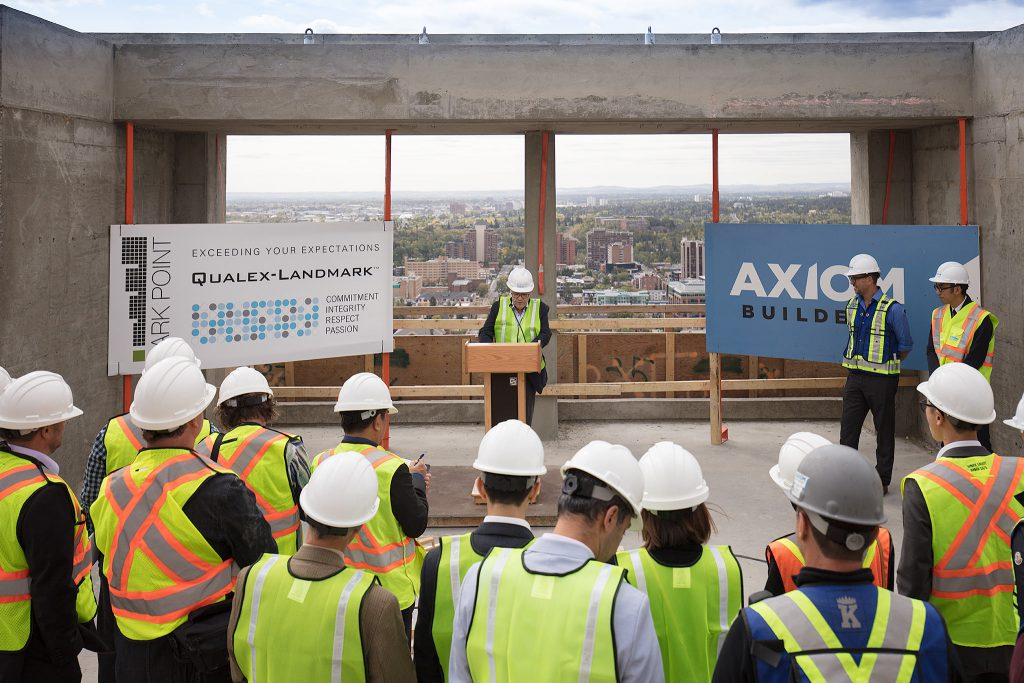 Mohammed Esfahani, president of Qualex-Landmark, speaks at the topping-off ceremony on the 34th floor of Park Point, while Mike McDonough, vice-president, Axiom Builders, and Tony Wai, lead architect, IBI Group, look on. The project is expected to be move-in ready by summer 2018.